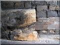 SP2864 : Bedrock and masonry, Westgate by Robin Stott