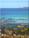 SW3526 : Rocky foreshore and clear blue sea at Sennen Cove by Rod Allday