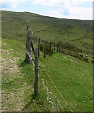 SH9124 : Fence near Bwlch y Groes by Mat Fascione