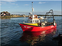 SZ1891 : Mudeford: Just Right comes ashore by Chris Downer