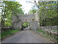 NU2519 : Archway over public Road near Dunstan by Ian Murfitt