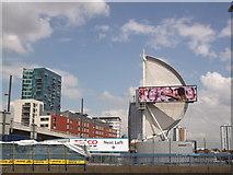 TQ3783 : Sail Advert and Stratford skyline by David Anstiss