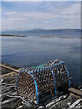 NR6880 : Lobster Pot On Old Stone Jetty by James T M Towill