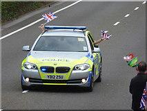 SZ0894 : Ensbury Park: a flag-waving police car by Chris Downer