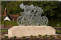 TQ1750 : Pixham End Roundabout cycling statue by Ian Capper