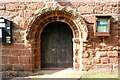 SJ4350 : Norman Doorway in St Edith's Church, Shocklach by Jeff Buck