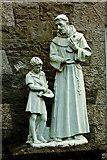 R3377 : Ennis - Francis Street - Franciscan Friary - Friar & Child Figures  by Joseph Mischyshyn