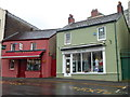 SN4120 : Two Blue Street clothes shops, Carmarthen by Jaggery