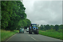 SU8214 : Tractors pass on the B2141 by Robin Webster