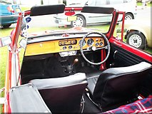 J0558 : The interior of a red Triumph Herald by P Flannagan