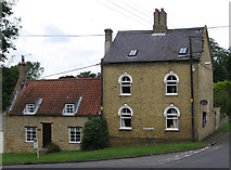 SK9859 : Boothby Graffoe - houses at top of Castle Lane by Dave Bevis