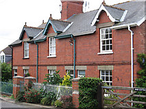 SK9859 : Boothby Graffoe - brick cottages on Main Street by Dave Bevis