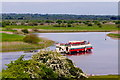 N0030 : Clonmacnoise - Excursion Boat leaving Clonmacnoise Dock by Suzanne Mischyshyn