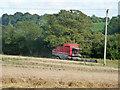 SU8418 : Red combine harvester by Robin Webster