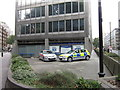 TQ2979 : Police cars at New Scotland Yard by Ian S