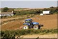 SW7754 : Tractor at work by Elizabeth Scott