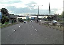 TQ1070 : A316 footbridge north of Park Road by Stuart Logan
