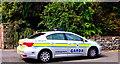 M2208 : The Burren - R477 - Ballyvaghan - Garda Car Parked at Monk's Pub & Restaurant by Suzanne Mischyshyn