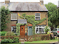 SP9014 : Topiary Olympic Flame on a Wilstone Cottage by Chris Reynolds