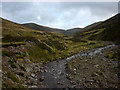 NN6575 : Heading up the Allt Coire Mhic-sith by Karl and Ali