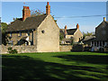 SP2304 : A small village green, Filkins by Nick Smith