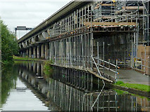 SP0990 : Canal, M6 flyover and scaffolding near Gravelly Hill by Roger  Kidd