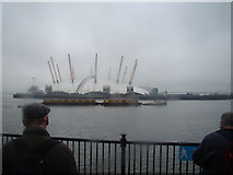 TQ3880 : Container barge passing the O2 by Robert Lamb