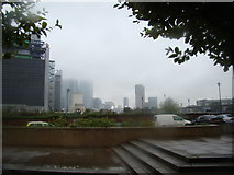 TQ3880 : View of Canary Wharf disappearing into the clouds from Virginia Wharf by Robert Lamb