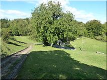 SU8216 : Footpath descent to Monkton Farm by Dave Spicer