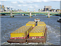 TQ3280 : Tug towing rubbish barges down the Thames by Graham Robson