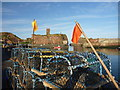 NT6779 : Coastal East Lothian : Creels and Flags at Victoria Harbour, Dunbar by Richard West