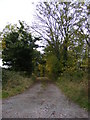 TM4072 : The entrance to South Manor Farm & footpath to Willow Marsh Lane by Adrian Cable