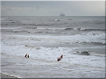 NZ3573 : Swimmers off Whitley Sands by Pauline E