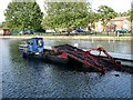 SK9871 : Weedcutting boat on the River Witham by Oliver Dixon