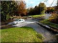 ST5678 : Car splashes through a minor flood on Henbury Road, Bristol by Jaggery