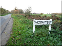 TQ1061 : Sign to Chestnut Farm on Old Common Road by David Howard