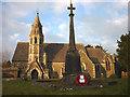 SD4692 : Poppy wreath on the war memorial, All Saint's Church, Underbarrow by Karl and Ali