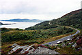 NR9974 : A8003 and parking place from the viewpoint on the hill above Tighnabruaich by Jo Turner