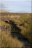 SD7148 : Smelt Mill Clough emerges from under the road by Ian Greig