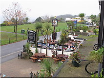 SX9265 : Babbacombe Downs Road - guesthouses and pub by David Hawgood
