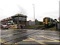 TQ5804 : Polegate station - level crossing by Stephen Craven