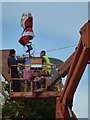 SZ0891 : Bournemouth: the unicycling Santa is repaired by Chris Downer