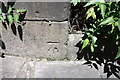 NZ2564 : Benchmark on buttress of Bridge ECM7/11, Manor Grove by Roger Templeman