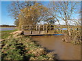 TL1281 : The Alconbury Brook in full flow by Michael Trolove