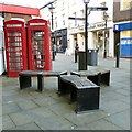 SJ8990 : Benches and listed phone boxes by Gerald England