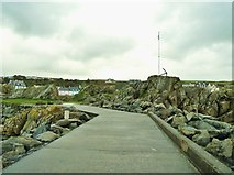 NW9954 : Flagpole and anchor on Dorn Rock by Ann Cook