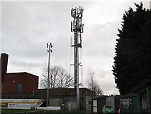 TQ4077 : Telecoms mast at Rectory Field by Stephen Craven