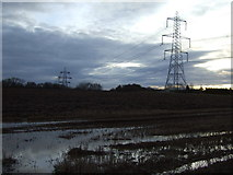 NZ4110 : Farmland and pylons off the B1264 by JThomas