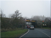 SO6913 : A48 northbound passing under a railway bridge by Colin Pyle