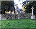 ST8287 : Stone cross and dry stone wall, Church of St Lawrence, Didmarton by Jaggery